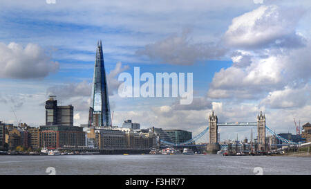 SHAD THAMES Cityscape of London Shard and Tower Bridge viewed from River Thames with Butlers Wharf and Shad Thames - Stock Photo