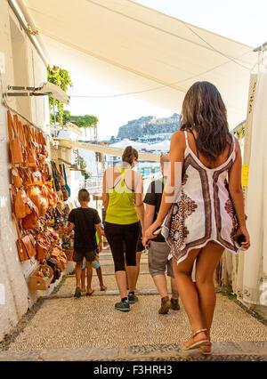 Tourists Walking Through The Street Market Lindos Rhodes Greece - Stock Photo