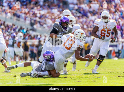 October 3rd, 2015:.Texas Longhorns quarterback Jerrod Heard (13) rolls out .as he is tackled by TCU Horned Frogs - Stock Photo