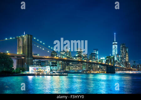 Beautiful night view of the Brooklyn Bridge looking towards Manhattan New York City - Stock Photo