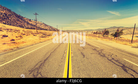 Retro old film style country highway in USA, travel adventure concept. - Stock Photo