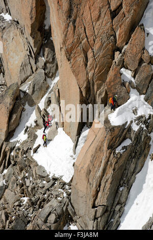 Mountaineers and climbers on a rock face, Aiguille du Midi, Mont Blanc Massif, Chamonix, French Alps, Haute Savoie, - Stock Photo