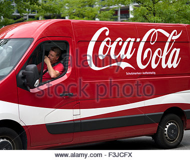 Coca-Cola Delivery Van And Driver - Munich Bavaria Germany Europe - Stock Photo