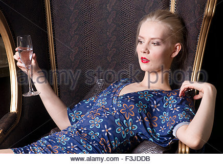 Young Woman Drinking Glass Of Wine - Stock Photo