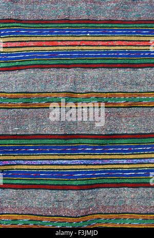 Handmade woven wool rug background - Stock Photo