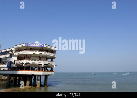 Naveen Beach Restaurant building on stilts Arabian sea Murudeshwar Uttar Kannada karnataka india - Stock Photo