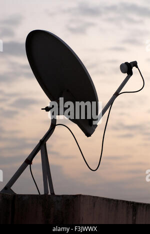 Dish Antenna on terrace of village house entertainment through satellite  village Otur Junnar Pune Maharashtra india - Stock Photo