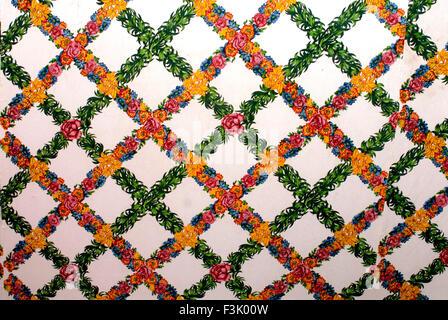 Floral design on cotton cloth used for decoration in Ganapati festival Pune Maharashtra India - Stock Photo