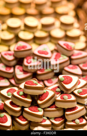 Heart chocolates display on a market stall - Stock Photo