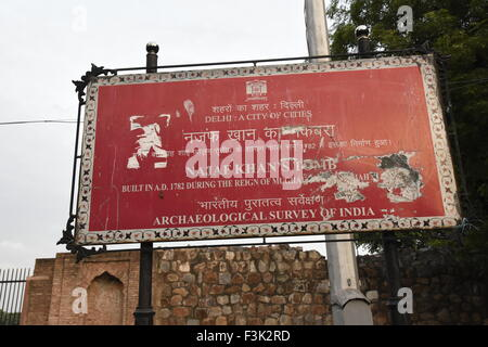 Najaf Khan Tomb Red color monument information board at entrance gate by Archaeological Survey of India(ASI) Delhi, - Stock Photo