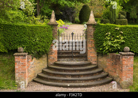 UK, England, Yorkshire East Riding, Goodmanham, semi circular steps leading to garden beside churchyard - Stock Photo