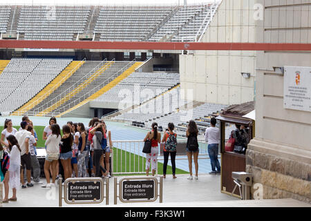 Tourists visiting the stadium of the 1992 Summer Olympic Games in Barcelona Spain - Stock Photo
