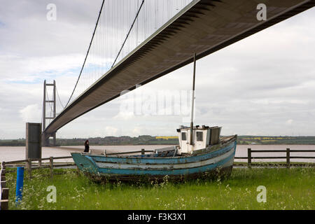 UK, England, Yorkshire East Riding, Hessle, old fishing boat below Humber Suspension Bridge - Stock Photo