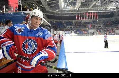 Russian President Vladimir Putin waits to get on the ice during the annual ice hockey match between former NHL stars - Stock Photo