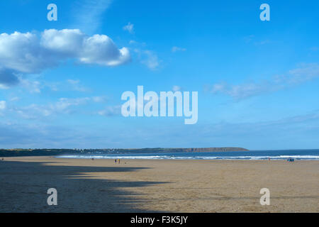 Blue sky day on the beach at Hunmanby Gap looking towards Filey - Yorkshire, England, UK - Stock Photo