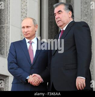 Russian President Vladimir Putin shakes hands with Tajik President Emomali Rahmon following the Collective Security - Stock Photo