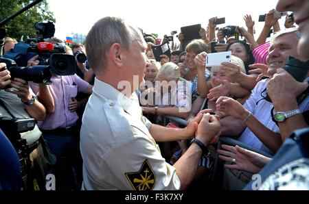Russian President Vladimir Putin greets supporters during a visit to the Black sea August 18, 2015 in Sevastopol, - Stock Photo