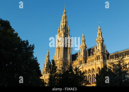 The outside of part of the Rathaus in Vienna during the morning. - Stock Photo