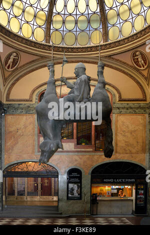 Statue of Saint Wenceslas sitting on the belly of a horse in the Lucerna passage in Prague. - Stock Photo
