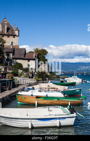 Boats tied up in the fishing harbour of Yvoire, Haute Savoie, France - Stock Photo