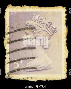 UNITED KINGDOM - CIRCA 1971: A postage stamp printed in United Kingdom shows a portrait of Queen Elizabeth II, circa - Stock Photo