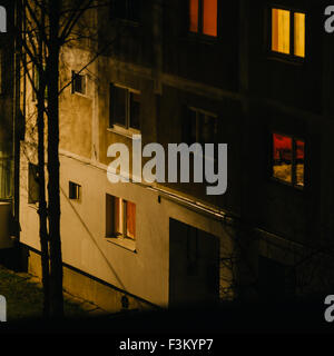 Apartments, windows, lights, concrete blocks in the night in Romania, panel houses constructed in communism. Urban - Stock Photo