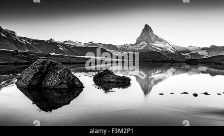 Sunset, Lights on the Matterhorn (Cervino). Lake Stellisee. - Stock Photo