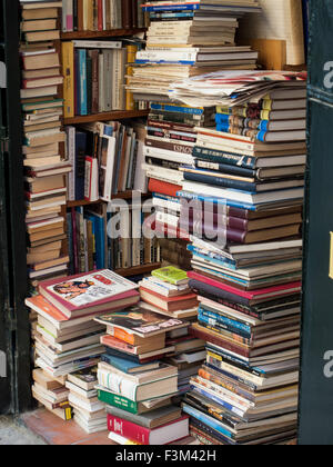 Bookshop with piled books in Seville, Spain. - Stock Photo