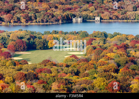 Aerial view of the Great Lawn and Jacqueline Kennedy Onassis Reservoir in Central Park with autumn foliage colors. - Stock Photo