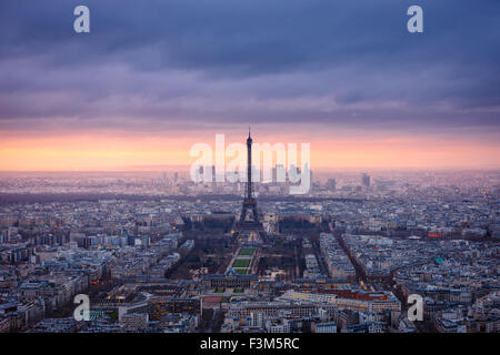 Paris cityscape clad in pink at dusk. Aerial view of Paris and the Eiffel Tower, Champ de Mars, Trocadero and La - Stock Photo