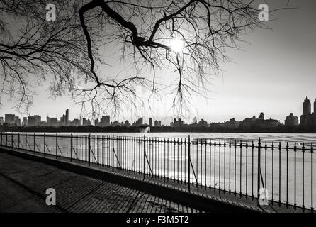 Black and White photograph of New York in winter, The Reservoir in Central Park and Upper West Side, NYC. - Stock Photo