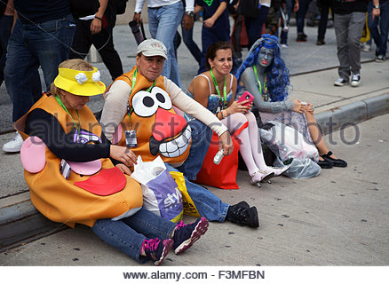New York, USA. 8th Oct, 2015. Adults dressed in costumes outside of the 10th annual New York Comic Con at the Jacob - Stock Photo