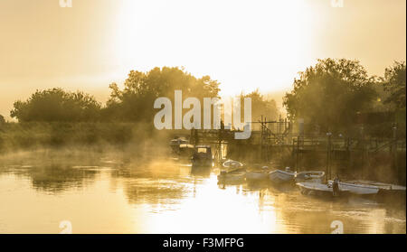 Evaporating steam fog rising over the River Arun on a cold morning in Arundel, West Sussex, England, UK. - Stock Photo