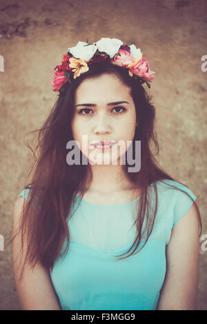 Beautiful young woman wearing a flower crown - Stock Photo