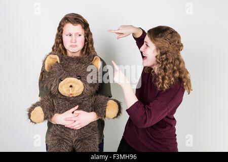 Girlfriends,Bullying,Teddy Bear,Sneering - Stock Photo