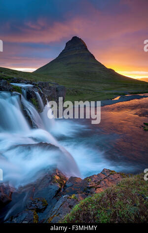 Dawn over Kirkjufell mountain and waterfall, Grundarfjordur, Snaefellsnes Peninsula, Vesturland, Iceland. - Stock Photo