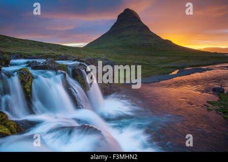 Dawn over Kirkjufell mountain and waterfall, Grundarfjordur, Snaefellsnes Peninsula, Vesturland, Iceland. - Stock Photo