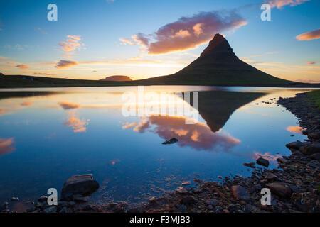 Sunset reflection of Kirkjufell mountain, Grundarfjordur, Snaefellsnes Peninsula, Vesturland, Iceland.