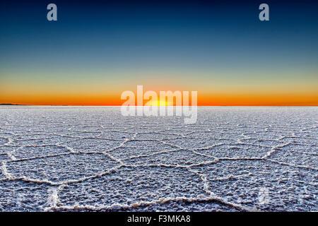 Sunrise in the Salar de Uyuni, Bolivia - Stock Photo