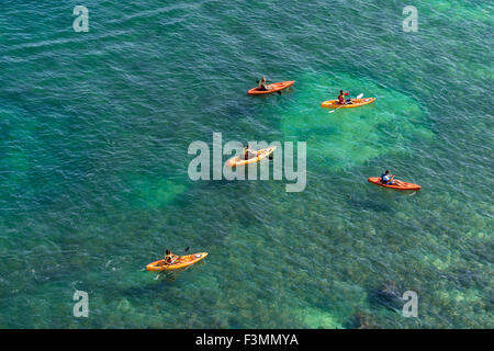 Close-up view of kayakers paddling through the crystal ocean waters in Portugal's Algarve. Near Lagos. August, 2015. - Stock Photo