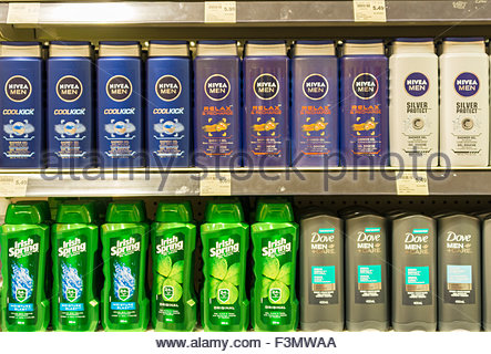 Nivea hygiene products in plastic bottles on the shelf. Nivea is a global skin- and body-care brand that is owned - Stock Photo