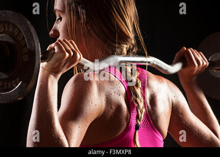 Fit woman lifting - Stock Photo