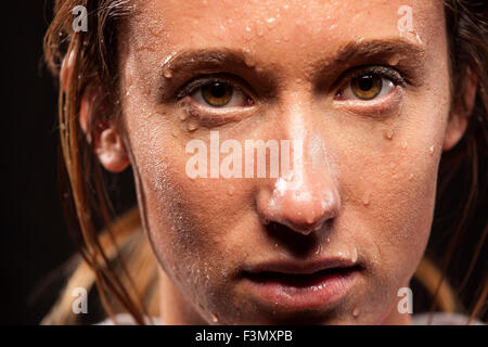 Woman with sweat on face - Stock Photo