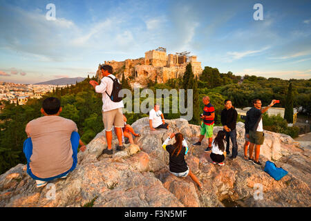 View of Acropolis from Areopagus hill with turists waiting for the sunset - Stock Photo