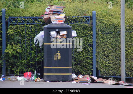 A litter bin overflows with rubbish on a street in Sheffield, South Yorkshire, England UK - Stock Photo