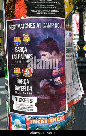 Street billboard advertising matches at Barecelona Football Club featuring Luis Suárez on Las Ramblas in Barcelona - Stock Photo