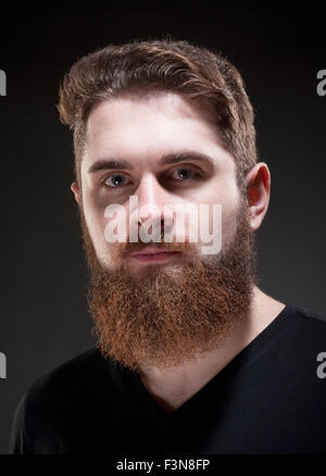 Portrait of a Teenage Hipster with Beard - Stock Photo