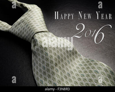 Elegant gray tie on a black background with Happy New Year 2016 as Text - Stock Photo