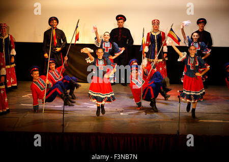 Russian Kozak (cossack) folk dancers perform live in Maroyla cinema stage. Lemnos island, Greece. - Stock Photo