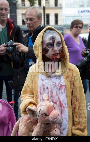 Leicester Square, UK,10th October 2016, Zombies in London on World Zombie Day raise funds for St Mungos Charity. - Stock Photo